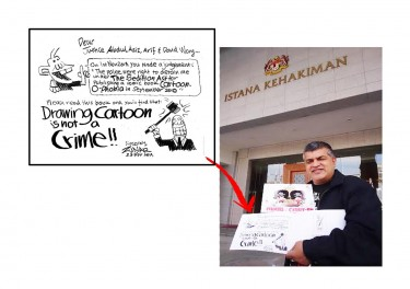 "Zulkiflee Anwar Ulhaque, aka ""Zunar"", outside the Appeals Court of Malaysia"