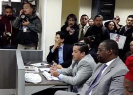 Bonil (far end of desk) on trial in Ecuador