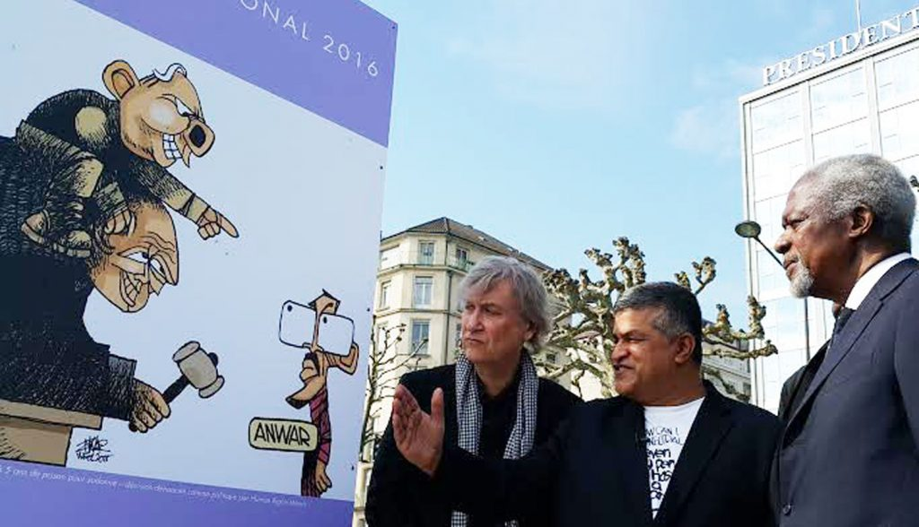 Left to right: Cartooning For Peace co-founder Plantu, Zunar and Kofi Annan