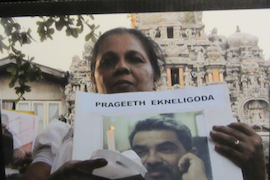 Sandya Eknaligoda holds up a photo of her husband Prageeth, on the 2nd anniversary of his disappearance